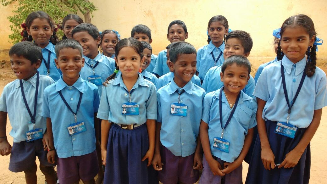 Giggly school kids proudly wearing the Smart Attendance ID card
